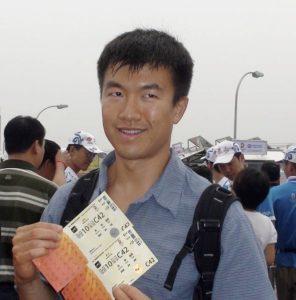 Simon holding ticket