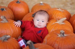 Ethan with pumpkin