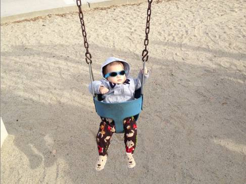 Ethan's first time on a swing