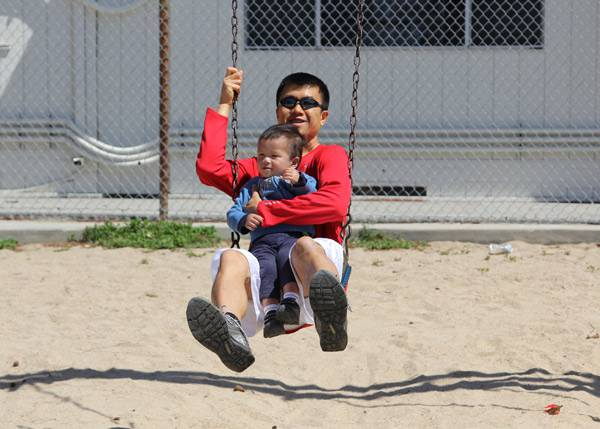 Simon Chan at the park with his son